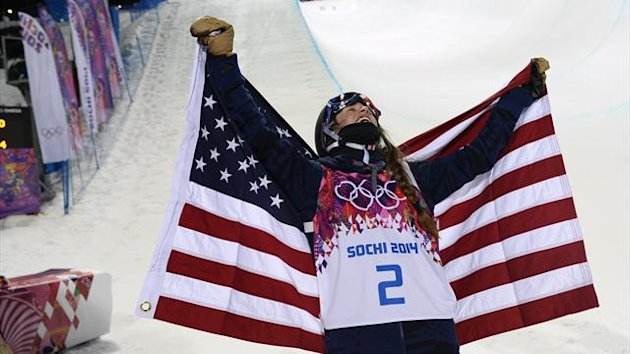 Winner Maddie Bowman of the US celebrates with the US flag after the women's freestyle skiing halfpipe finals (Reuters)