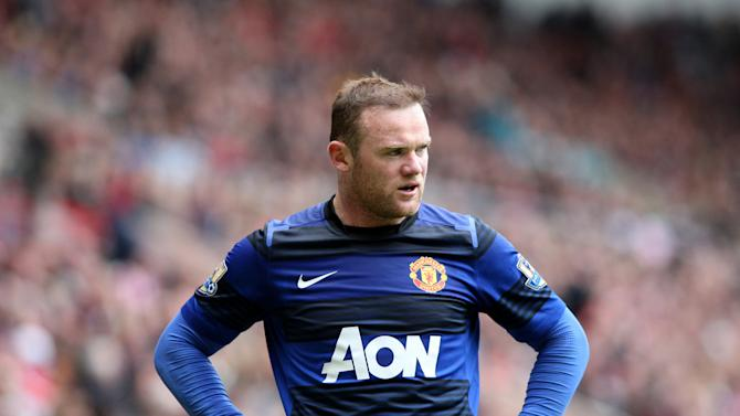 Manchester United's Wayne Rooney stands dejected after losing the English Premier League title at the end of their match against Sunderland at the Stadium of Light, Sunderland, England, Sunday, May 13, 2012. Manchester City won the English Premier League title. (AP Photo/Scott Heppell)