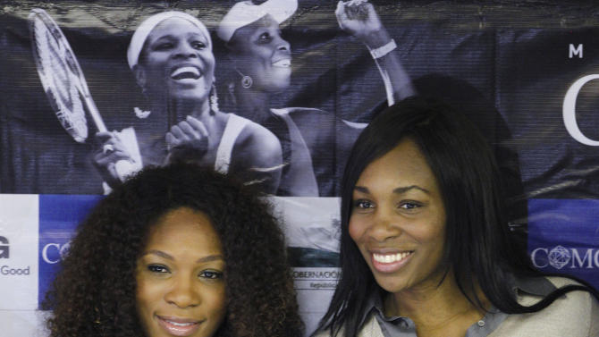FILE - This Nov. 22, 2011 file photo shows Serena, left, and Venus Williams posed during a news conference prior to an exhibition tennis match,  in Bogota, Colombia. Almost from the moment the Williams sisters appeared on the Grand Slam scene in the late 1990s, they've been winning titles and transcending tennis, becoming red-carpet celebrities as much as sports stars.  (AP Photo/Fernando Vergara, File)