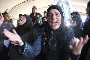 Relatives of captured Lebanese soldiers react during …