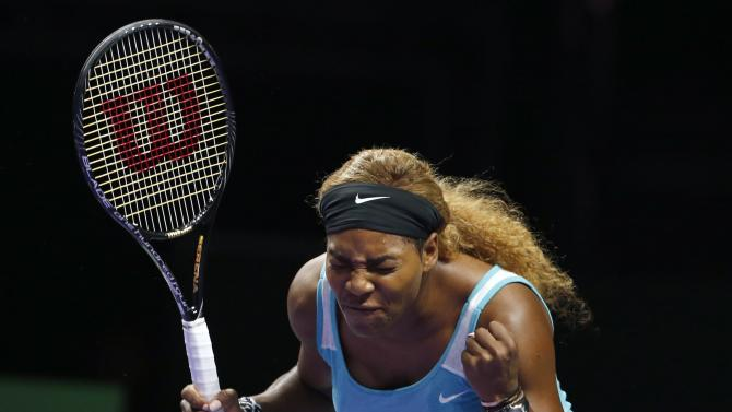 Serena Williams of the U.S. reacts as she plays against Simona Halep of Romania during their WTA Finals singles tennis match at the Singapore Indoor Stadium