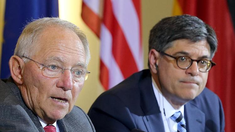 German Finance Minister Wolfgang Schaeuble , left, and US Secretary of the Treasury Jacob Lew attend a press conference after a meeting in Berlin, Germany, Thursday June 19, 2014. (AP Photo/dpa, Wolfgang Kumm)