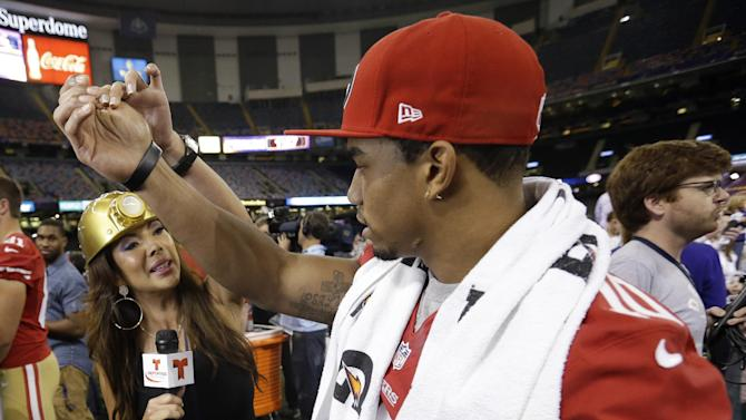 Telemundo's Mireya Grisales interviews San Francisco 49ers wide receiver Kyle Williams during media day for the NFL Super Bowl XLVII football game Tuesday, Jan. 29, 2013, in New Orleans. (AP Photo/Pat Semansky)