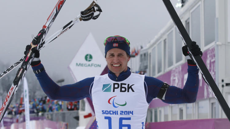 Norway's Ulset celebrates his silver medal during the men's 15 km biathlon standing at the 2014 Sochi Paralympic Winter Games in Rosa Khutor