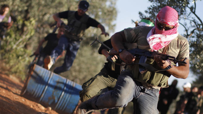 Free Syrian Army members train with their weapons on the outskirts of Idlib, Syria, Thursday, June 7, 2012.  (AP Photo)