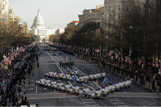 The 57th Presidential Inaugural Parade rolls down Pennsylvania Avenue from Capitol Hill in Washington, Monday,Jan. 21,2013, following President Barack Obama's ceremonial swearing-in ceremony during th