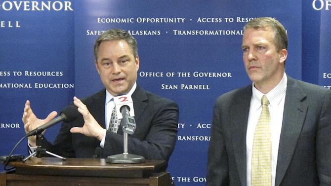 Alaska Gov. Sean Parnell, left, and Natural Resources Commissioner Dan Sullivan appear at a news conference Friday, March 30, 2012, in Anchorage, Alaska, confirming that a settlement over disputes on leases in the Point Thomson gas fields had been reached with Exxon Mobil Corp., BP PLC and ConocoPhillips. (AP Photo/Mark Thiessen)
