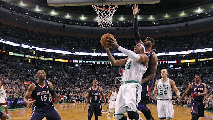Boston Celtics small forward Paul Pierce (34) drives to the basket against Atlanta Hawks power forward Josh Smith (5) and center Al Horford (15) during the first quarter of Game 6 in a first-round NBA basketball playoff series in Boston, Thursday, May 10, 2012. (AP Photo/Charles Krupa)