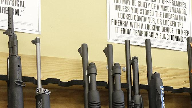 General manager Steve Alcairo shows shotguns on the shelf while being interviewed at High Bridge Arms Inc. in San Francisco, Wednesday, Dec. 19, 2012. Anxious parents reeling in the wake the Connecticut school shooting are fueling sales of armored backpacks for children emblazoned with Disney and Avengers logos, as firearms enthusiasts stock up on assault rifles nationwide amid fears of imminent gun control measures. At Amendment II, sales of children's backpacks and armored inserts are up 300 percent. (AP Photo/Jeff Chiu)