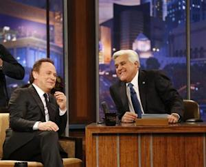 """Leno is pictured with Crystal during a commercial break while taping the last episode of """"The Tonight Show with Jay Leno"""" in Burbank"""