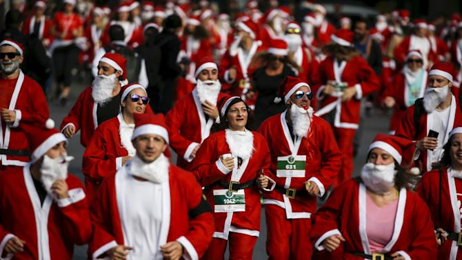 People dressed in Santa costumes take part in the Santa Claus Run in Athens