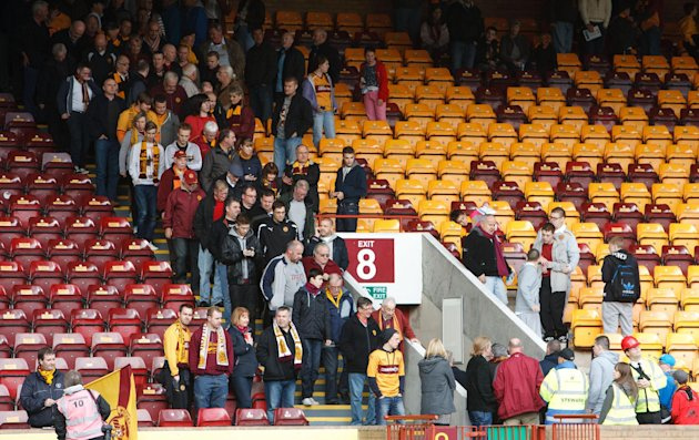 Supporters leave the stands as the match between Motherwell and Dundee United is abandoned
