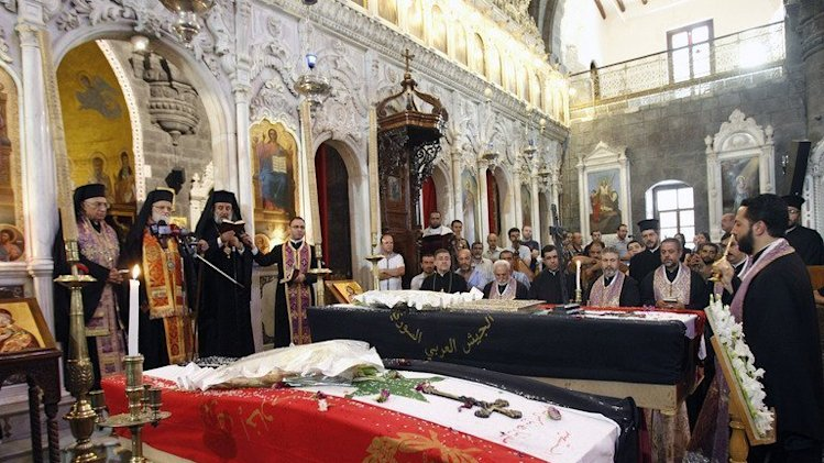 The funeral in Damascus on September 10, 2013, of three Christians killed in Maalula at the weekend