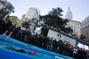 U.S. long-distance swimmer Nyad begins her 48 hour continuous swim at Herald Square in New York