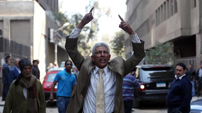 A man reacts after Egyptian police arrest Ahmed Qaddaf al-Dam, cousin of Libya's former dictator Moammar Gadhafi, not pictured, after being arrested in Cairo, Egypt, Tuesday, March 19. 2013. Egyptian security forces arrested a cousin of Libya's former dictator Moammar Gadhafi on Tuesday following an hours-long siege of his home in central Cairo, a security official and witnesses said. (AP Photo/Khalil Hamra)