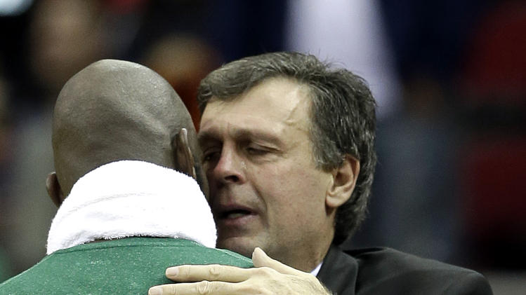 Houston Rockets coach Kevin McHale, right, is hugged by Boston Celtics' Kevin Garnett after an NBA basketball game Friday, Dec. 14, 2012, in Houston. McHale's daughter died recently. The Rockets beat the Celtics 101-89. (AP Photo/David J. Phillip)
