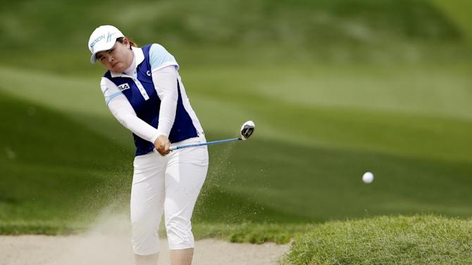 Inbee Park, of South Korea, watches her shot from the fairway bunker on the second hole during the final round of the LPGA Kraft Nabisco Championship golf tournament in Rancho Mirage, Calif., Sunday, April 7, 2013. (AP Photo/Chris Carlson)