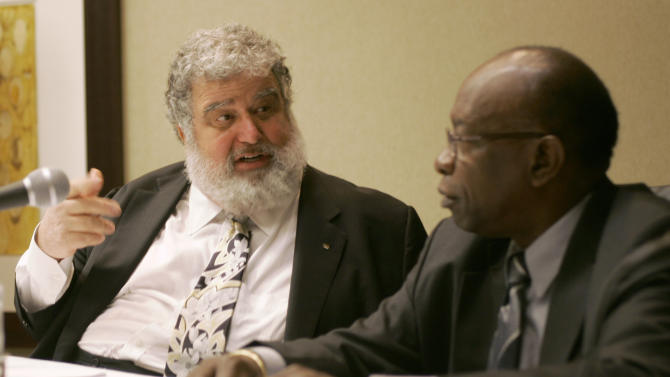 FILE - In this Jan. 28, 2008 file photo, Confederation of North, Central American and Caribbean Association Football (CONCACAF) General Secretary Chuck Blazer, left, and President Jack Warner chat during a news conference, in Miami. A CONCACAF ethics and integrity committee have accused Warner and Blazer of enriching themselves with the regional soccer organization's money, in a 100-page report presented at the group's congress in Panama City, Friday, April 20, 2013, with FIFA President Joseph S. Blatter in attendance. (AP Photo/Wilfredo Lee, File)