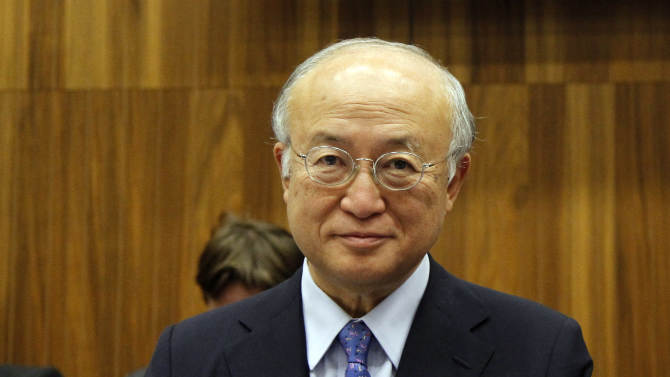 FILE - A Friday, Nov. 30, 2012 photo from files showing Director General of the International Atomic Energy Agency, IAEA, Yukiya Amano from Japan waiting for the start of the IAEA board of governors meeting at the International Center in Vienna, Austria. The head of the U.N. nuclear agency appears on track to stay in office for a second term, with his organization saying that no other candidate has stepped forward to challenge him, Monday, Jan. 7, 2013. The lack of competition means that International Atomic Energy Agency chief Yukiya Amano will likely be approved by the IAEA's board of governors to run the agency for four more years. (AP Photo/Ronald Zak, File)