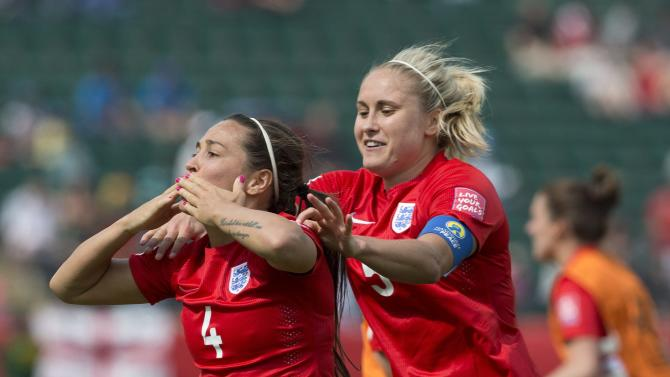 England's Fara Williams (4) celebrates a goal from a penalty kick against Germany during extra time action of the FIFA Women's World Cup soccer third-place match in Edmonton, Alberta, Canada, on Saturday, July 4, 2015. (Jason Franson/The Canadian Press via AP) MANDATORY CREDIT