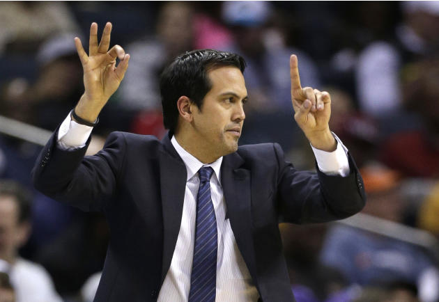 Miami Heat head coach Erik Spoelstra directs his team against the Charlotte Bobcats during the first half of an NBA basketball game in Charlotte, N.C., Saturday, Jan. 18, 2014. (AP Photo/Chuck Burton)