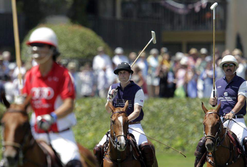Prince William, Duke of Cambridge, center, is shown prior to the start of the charity polo match at The Santa Barbara Polo & Racquet club on Saturday, July 9, 2011 in Carpinteria Calif.  The event is held in support of The American Friends of The Foundation of Prince William and Prince Harry. (AP Photo/Jae Hong)