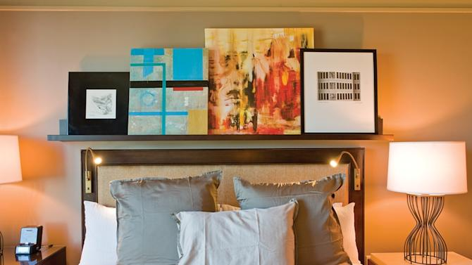 This undated photo supplied by H+K Strategies shows artwork in an Omni Dallas Hotel guest room. Omni is one of a number of hotels that features unusual art in the rooms and allows guests the option of purchasing the work to take home. For several years, hotels have invited local artists in to decorate hallways, lobbies and other public spaces. It's a way they can distinguish themselves from the cookie-cutter chains and offer guests a sense of their unique city or town. Now, they are taking that partnership one step further and turning bedrooms into mini-salesrooms. (AP Photo/Omni Dallas Hotel, Jeremy McKane)