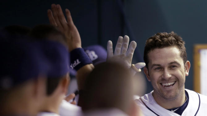 Tampa Bay Rays' Evan Longoria, right, high fives teammates in the dugout after his fourth-inning home run off Baltimore Orioles starting pitcher Chris Tillman during a baseball game Wednesday, Oct. 3, 2012, in St. Petersburg, Fla. (AP Photo/Chris O'Meara)