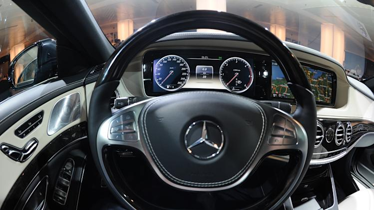 The cockpit of the new S-Class Mercedes is seen during the presentation in Hamburg, Germany, Wednesday, May 15, 2013. The new Mercedes is supposed to have lower fuel consumption and high security standards due to driving assistance.. (AP Photo/dpa/Marcus Brandt)