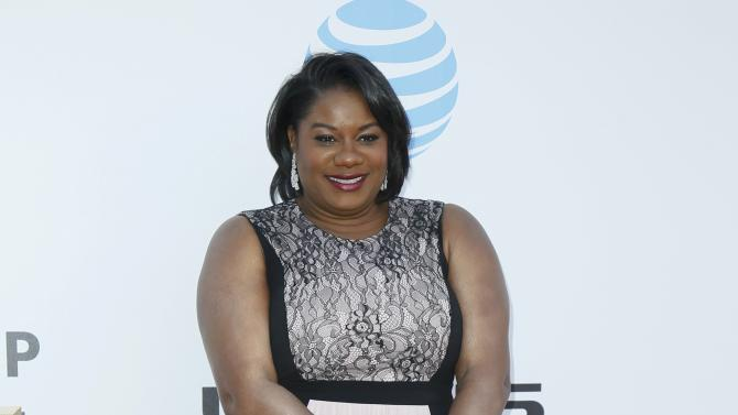 Actress Adrienne C. Moore arrives at the 47th NAACP Image Awards in Pasadena