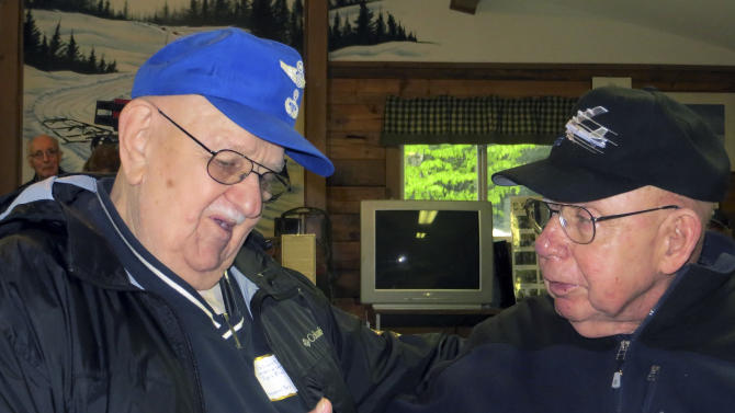 Eugene Slabinski, left, 83, of Hanover Township, Pa., sits with Gerald Alder, 81, of Davis, Calif., in Greenville, Maine, at a 50th anniversary remembrance of a B-52 crash in January 1963 on Elephant Mountain, Maine.  Slabinski, an Air Force medic, dropped from a helicopter to rescue Adler, one of two survivors of the crash. Seven other crew members died. (AP Photo/David Sharp)