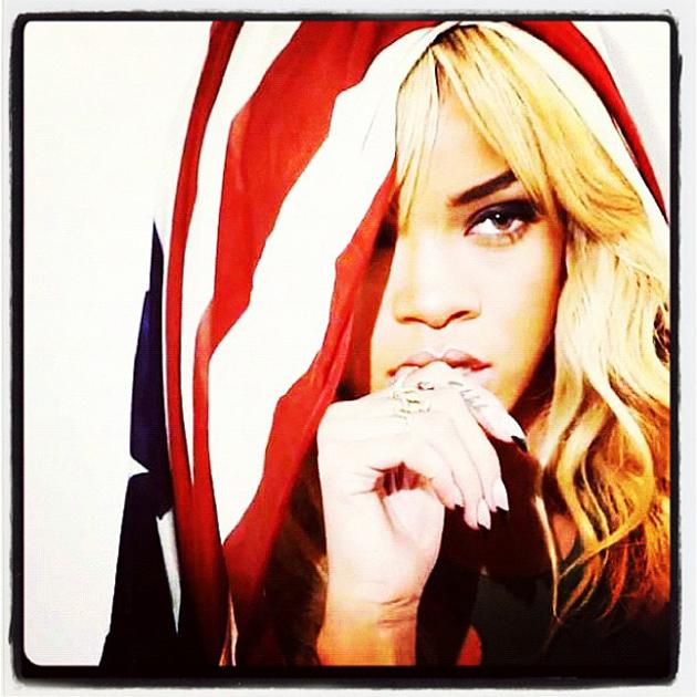 Celebrity photos: Rihanna is the queen of Twitpics and this one was no exception. The singer tweeted this striking image of her with the American flag draped across her head. Stunning. [Copyright: Rih