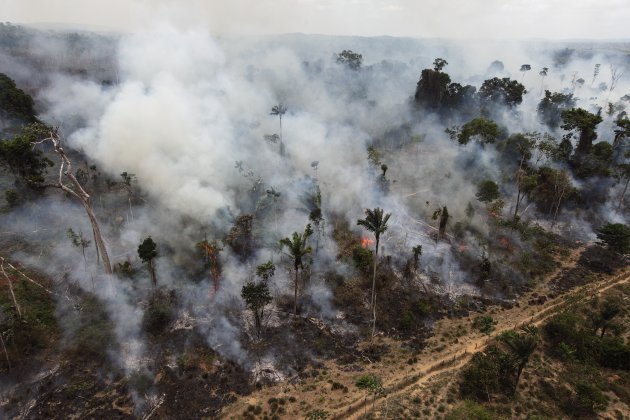 FILE - In this Sept. 15, 2009, file photo a forest in the Amazon is seen being illegally burnt, near Novo Progresso, in the northern Brazilian state of Para. Brazil's lower house of Congress is expected to vote Tuesday, April 24, 2012, on changes to the nation's benchmark environmental law that detractors say would weaken protections for the Amazon rainforest and stoke more destruction. (AP Photo/Andre Penner, file)