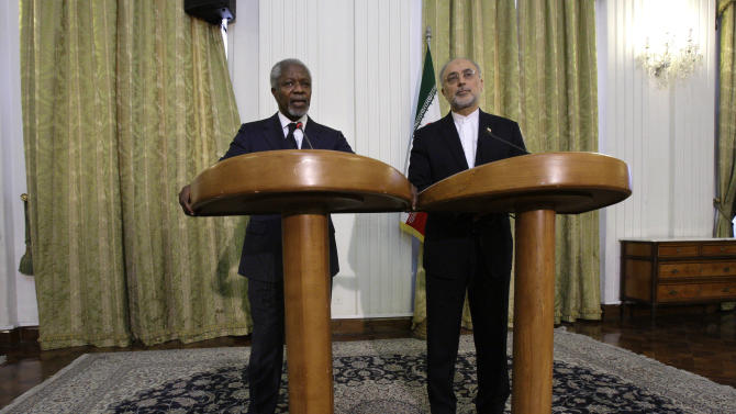 """International envoy Kofi Annan, left, speaks during a joint press conference with Iranian Foreign Minister Ali Akbar Salehi in Tehran, Iran, Wednesday, April 11, 2012. Annan, the U.N.-Arab League envoy, has appealed to Syria's key ally Iran to support his plan to end the violence wracking the Arab country, saying that """"any further militarization of the conflict would be disastrous."""" (AP Photo/Vahid Salemi)"""
