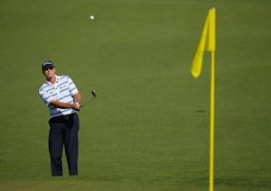 U.S. golfer Steve Stricker hits a shot onto the second green during the first round of the 2014 Masters golf tournament at the Augusta National Golf Club in Augusta