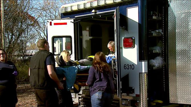 This image provided by WSBT-TV shows paramedics helping an Amtrak passenger into an ambulance after the train she was on derailed Sunday, Oct. 21, 2012 near Niles in southwest Michigan. An Amtrak spokesman said about a dozen people were hurt, none seriously in the incident. (AP Photo/WSBT-TV)