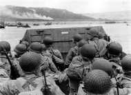 American troops watch activity ashore on Omaha Beach as their LCVP landing craft approaches the shore in this June 6, 1944 handout photo obtained by Reuters June 1, 2012. REUTERS/U.S. National Archives/Handout
