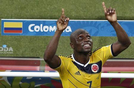 Colombia's Pablo Armero celebrates after their win against Japan as he leaves the pitch after their 2014 World Cup Group C soccer match at the Pantanal arena in Cuiaba