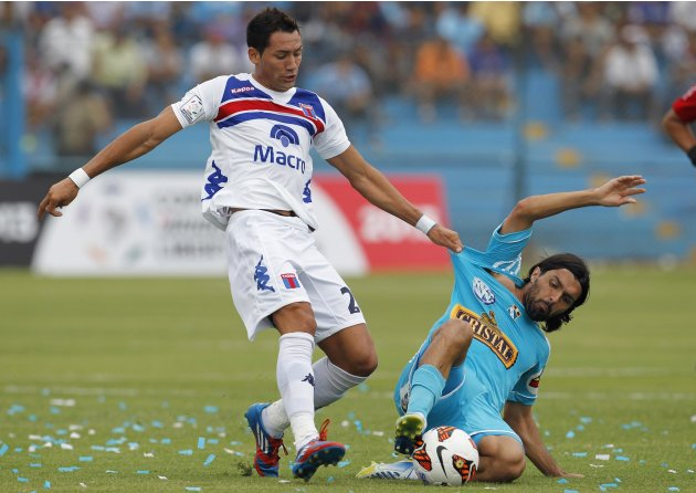 Paparatto of Argentina's Tigre and Cazulo of Peru's Sporting Cristal compete for the ball during their Libertadores Cup soccer match in Lima