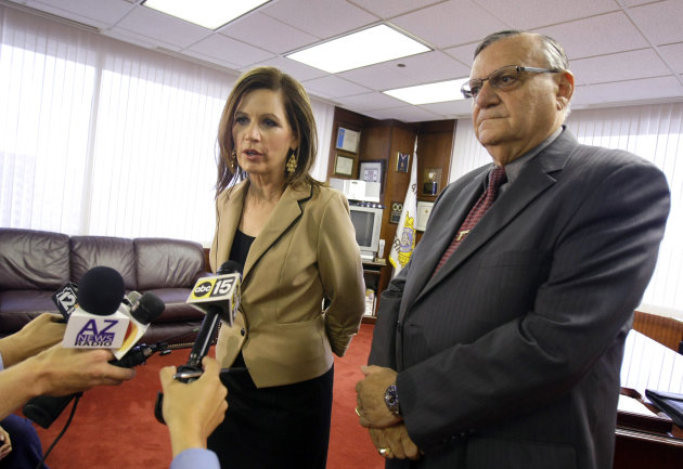 Republican presidential candidate Rep. Michele Bachmann, R-Minn., answers questions regarding illegal immigration issues plaguing Arizona during a news conference with Maricopa County Sheriff Joe Arpaio, right, at his office Wednesday, Sept. 14, 2011, in Phoenix. (AP Photo/Paul Connors))
