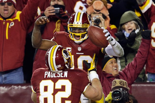 LANDOVER, MD - DECEMBER 30: Robert Griffin III #10 celebrates his third quarter touchdown against the Dallas Cowboys with Logan Paulsen #82 of the Washington Redskins at FedExField on December 30, 2012 in Landover, Maryland.  (Photo by Rob Carr/Getty Images)