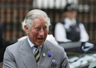 Britain's Prince Charles smiles as he arrives at the Lindo Wing of St Mary's Hospital the day after Catherine, Duchess of Cambridge, gave birth to a baby boy, in London July 23, 2013. REUTERS/Stefan Wermuth/Files