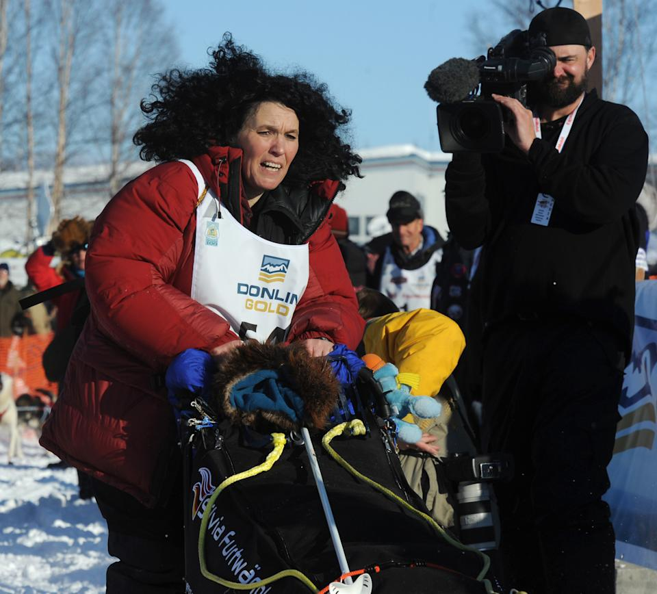 Silvia Furtwaengler, of Germany, hits the trail during the official start of the Iditarod Trail Sled Dog Race in Willow, Alaska, on Sunday, March 4, 2012. (AP Photo/Anchorage Daily News, Bill Roth)