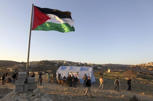 A flag flies near a newly-erected tent in the West Bank village of Beit Iksa, between Ramallah and Jerusalem
