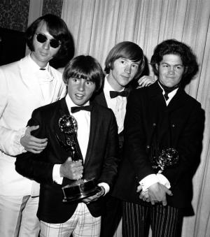 "FILE - This June 4, 1967 file photo shows The Monkees posing with their Emmy award at the 19th Annual Primetime Emmy Awards in Calif. The group members are, from left to right, Mike Nesmith, Davy Jones, Peter Tork, and Micky Dolenz. Jones died Wednesday Feb. 29, 2012 in Florida. He was 66. Jones rose to fame in 1965 when he joined The Monkees, a British popular rock group formed for a television show. Jones sang lead vocals on songs like ""I Wanna Be Free"" and ""Daydream Believer.""     (AP Photo, File)"