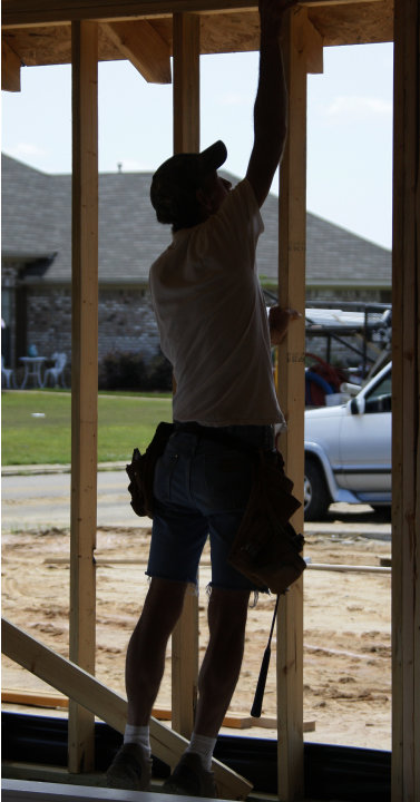 In this Friday, June 1, 2012, photo, John Knight uses a air hammer as he frames a new house on this lot in the Patrick Farms community  in Pearl, Miss. Confidence among U.S. builders ticked up in June