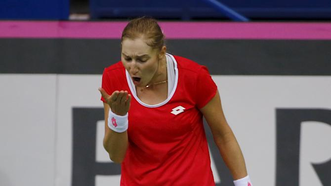 Ekaterina Makarova of Russia reacts after losing a point during her Fed Cup World Group tennis match against Kiki Bertens of the Netherlands in Moscow