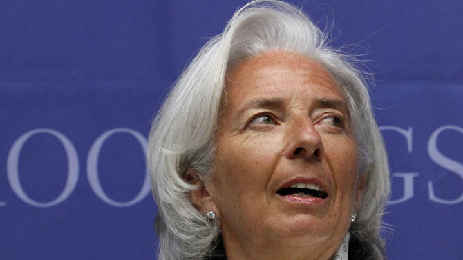 """FILE - In this Tuesday, June 4, 2013, file photo, IMF Managing Director Christine Lagarde listens as she is introduced at Brookings in Washington. """"There are signs that the U.S. recovery is gaining ground and becoming more durable,"""" Christine Lagarde, the IMF's managing director, said in a written statement on Friday, June 14, 2013. (AP Photo/Ann Heisenfelt, File)"""