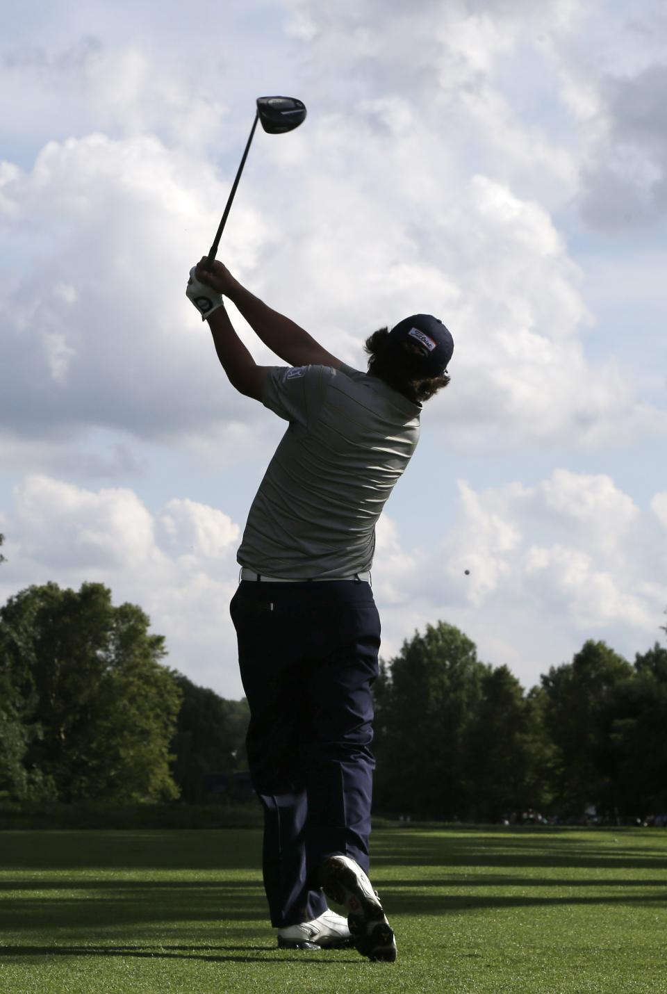 Jason Dufner watches his tee shot on the 16th hole during the second round of the PGA Championship golf tournament at Oak Hill Country Club, Friday, Aug. 9, 2013, in Pittsford, N.Y. (AP Photo/Charlie Neibergall)