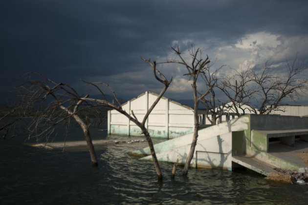 In this Sept. 5, 2012, a structure sits submerged in Lake Azuei seen near Jimani, Dominican Republic, near the border with Haiti. The waters' rise has worsened exponentially in recent years, especially after heavy rains in 2007 and 2008 hit the island of Hispaniola. Tropical Storm Isaac dumped more water on the region last month, sparking more damage. (AP Photo/Dieu Nalio Chery)
